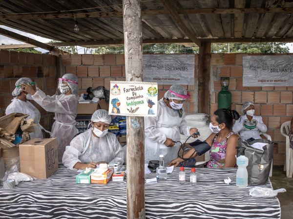 Indigenous health care workers treat patients last week at a campaign hospital set up in the Parque das Tribos neighborhood of Manaus, Brazil. Oxygen shortages at hospitals in Brazil's Amazon prompted authorities to impose a curfew and airlift patients to other states.