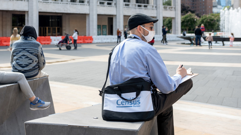 A U.S. census worker sits in the plaza of the Lincoln Center for the Performing Arts in New York City in September. The Census Bureau announced Wednesday that the first results of the 2020 census are expected to be released by April 30. (Alexi Rosenfeld/Getty Images)
