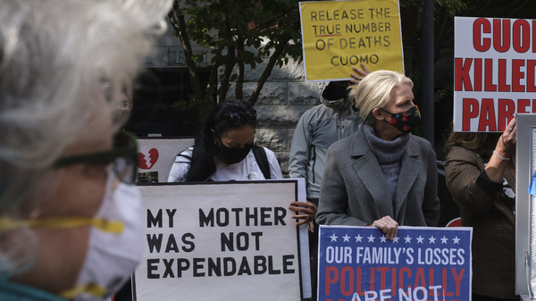 Families of COVID-19 victims who died in New York nursing homes gather in front of the Cobble Hill Heath Center in the Brooklyn borough of New York City in October. A report issued Thursday by New York