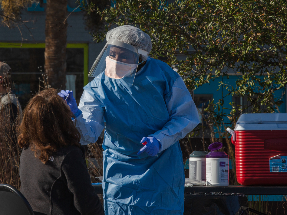 A health care worker from the Medical University of South Carolina administers a coronavirus test this month in Charleston, S.C. U.S. health authorities said Thursday that the first U.S. cases of the variant that emerged from South Africa were detected in South Carolina. (Micah Green/Bloomberg via Getty Images)