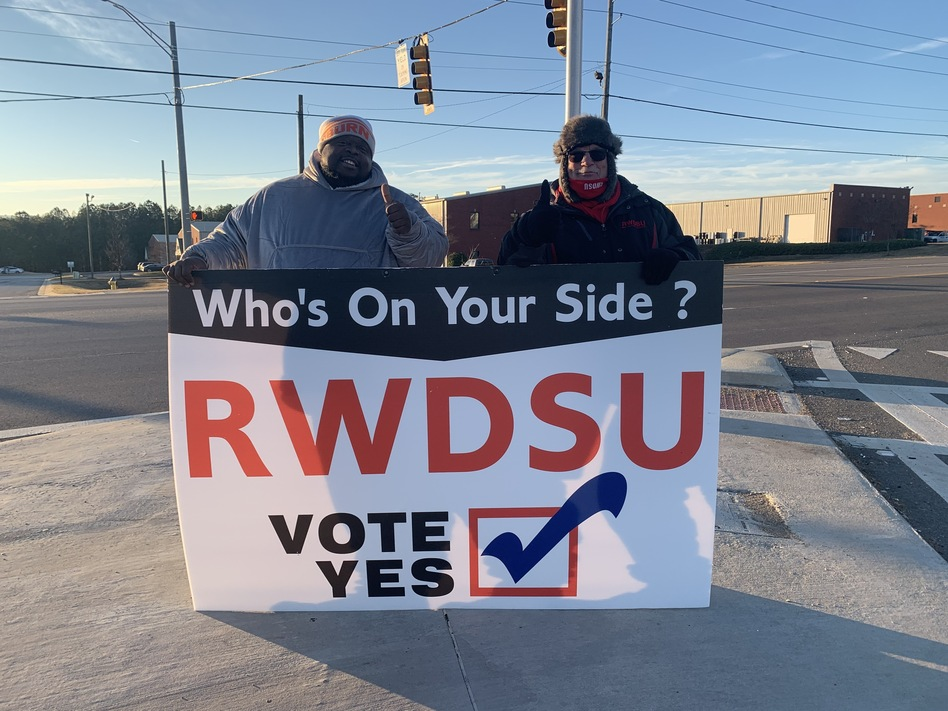 Representatives from the Retail, Wholesale and Department Store Union hold a pro-unionization sign outside Amazon's warehouse in Bessemer, Ala. (Miranda Fulmore/WBHM)