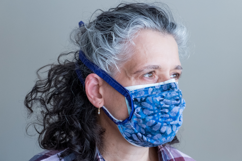 Layering a cloth mask on top of a surgical mask helps achieve a tighter fit while also adding an extra layer of filtration. Double-masking like this increases protection against the coronavirus. (Michele Abercrombie/NPR)