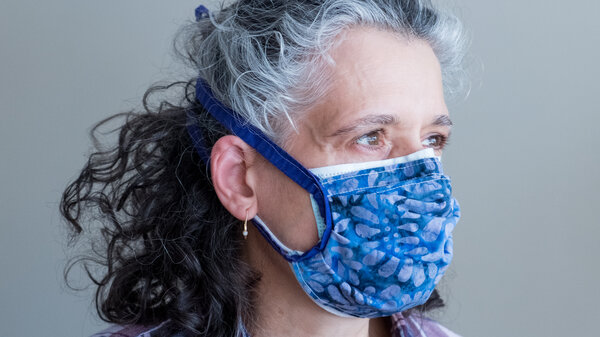 Layering a cloth mask on top of a surgical mask helps achieve a tighter fit while also adding an extra layer of filtration. Double-masking like this increases protection against the coronavirus.