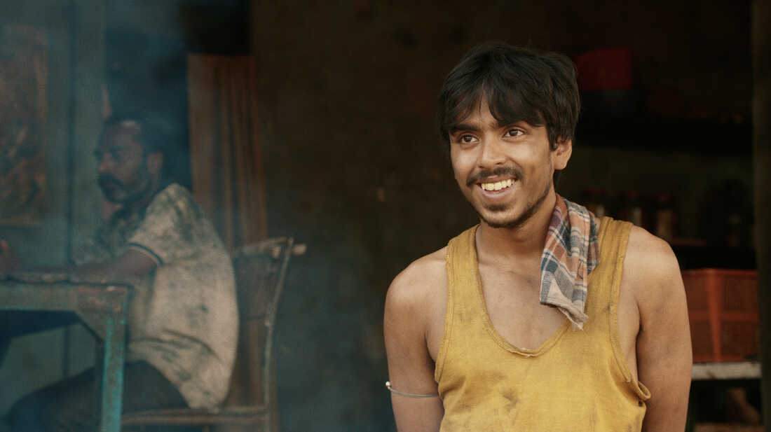 """He is """"the white tiger"""" — a poor villager, Balram, portrayed by actor Adarsh Gourav, who is determined to use his intelligence to escape a life of poverty."""