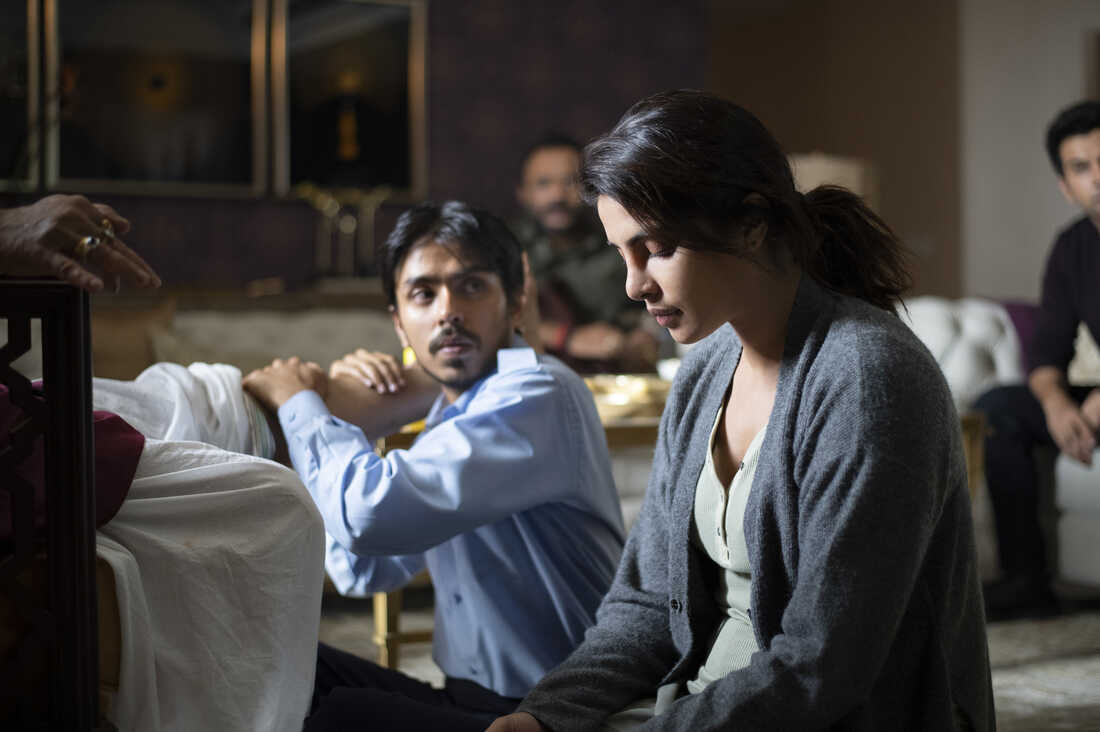 As the driver for a rich couple, Balram is tasked with massaging the tired legs of his boss Ashok (Rajkummar Rao) while his wife Pinky (Priyanka Chopra Jonas) looks on. Jonas, was one of the producers for the film, which chronicles Balram's attempt to rise out of poverty.