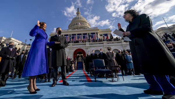 Kamala Harris is sworn in as vice president by Supreme Court Justice Sonia Sotomayor as Harris' husband, Doug Emhoff, holds the Bible. Harris is the first woman to be vice president, and the first person of Black or South Asian heritage to hold the office.