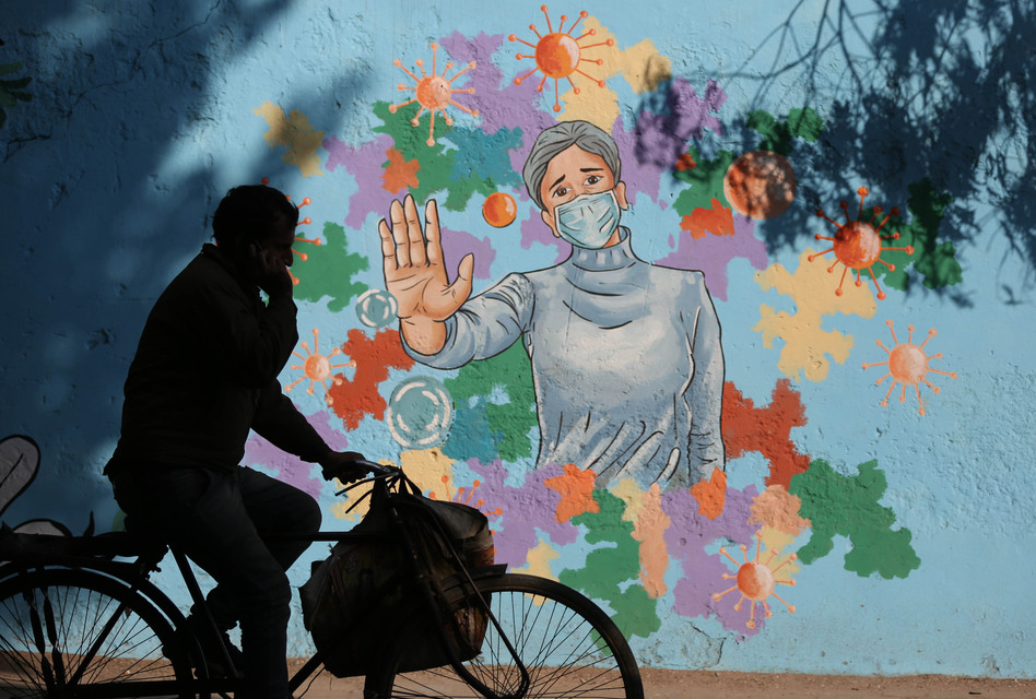 A mural in New Delhi is part of public health messaging in India. The country has seen a dramatic decline in new cases since the fall, but researchers aren't sure why. (Sanchit Khanna/Hindustan Times via Getty Images)