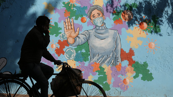 A mural in New Delhi is part of public health messaging in India. The country has seen a dramatic decline in new cases since the fall, but researchers aren