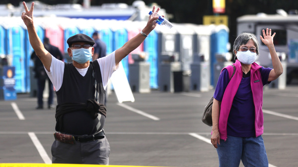 Southern Californians celebrate at a mass vaccination site in Disneyland