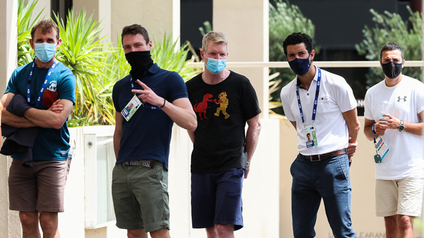 People associated with the Australian Open are seen lining up at a testing facility at the View Hotel on Thursday in Melbourne, Australia. Victoria state has reintroduced COVID-19 restrictions after a hotel quarantine worker tested positive for the coronavirus on Wednesday.