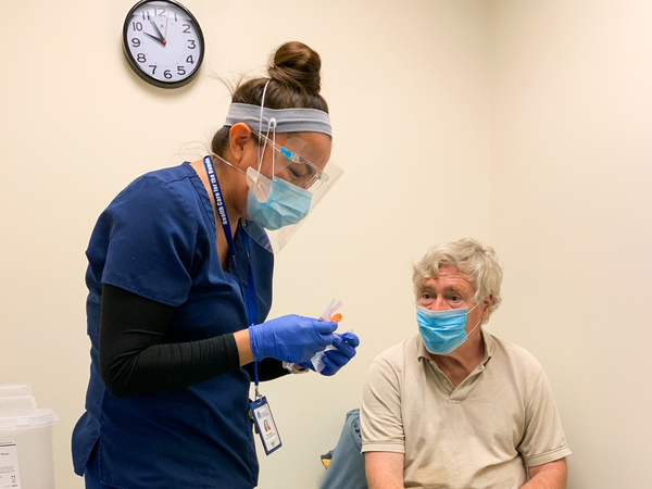 Nurse Modesta Littleman vaccinates patient Peter Sulewski in late January, on the first day of vaccinations at a clinic run by Health Care for the Homeless in Baltimore.