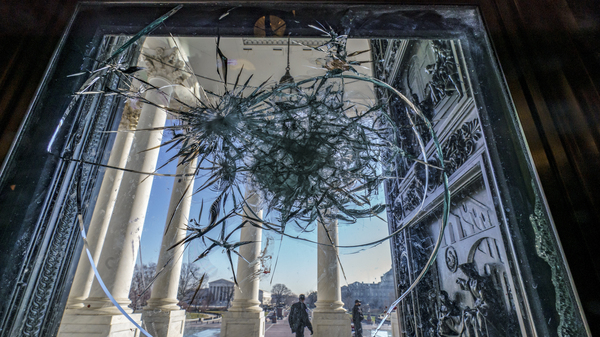 In this Jan. 12, 2021 photo, shattered glass from the attack on Congress by a pro-Trump mob is seen in the doors leading to the Capitol Rotunda.
