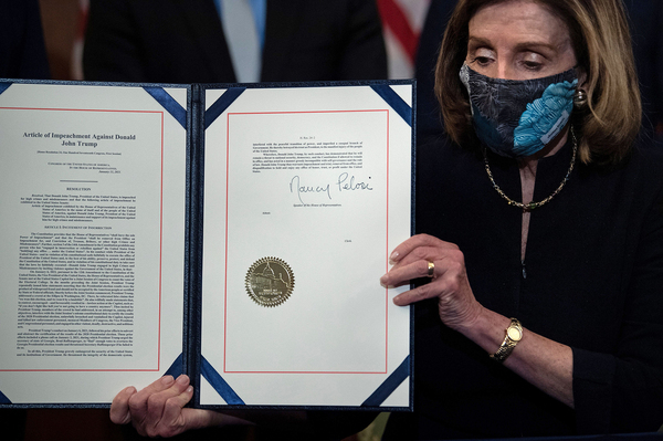 Speaker of the House Nancy Pelosi (D-CA), holds the signed article of impeachment, during an engrossment ceremony after the US House of Representatives voted to impeach the US President Donald Trump at the US Capitol, January 13, 2021, in Washington, DC.