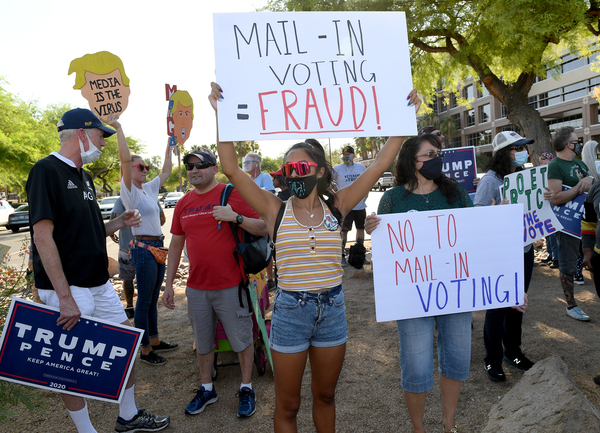 Trump supporters protest against the passage of a mail-in voting bill during a Nevada Republican Party demonstration.