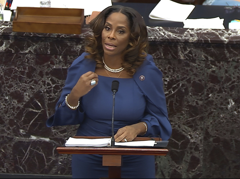 """House impeachment manager Del. Stacey Plaskett, D-Virgin Islands, drew a stark comparison between the Americans who """"sacrificed their lives for love of country, honor, duty"""" by stopping foreign terrorists from striking the Capitol on 9/11, and the insurgents who were """"incited"""" by Trump to attack the seat of government. (Handout photo provided by Senate television/AP)"""