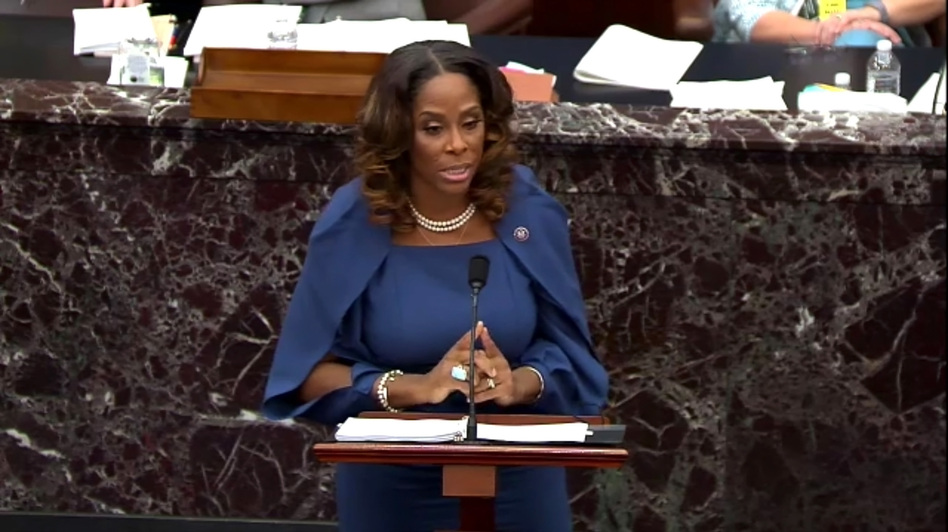 Del. Stacey Plaskett of the U.S. Virgin Islands, a House impeachment manager, played senators new video and audio footage documenting the violent mayhem of the insurrection at the U.S. Capitol on Jan. 6. (Handout/Getty Images)