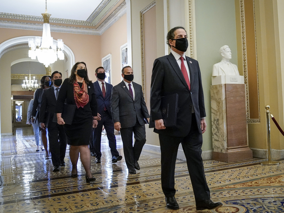 Led by lead manager Rep. Jamie Raskin, D-Md., House impeachment managers walk to the Senate Chamber on the first day of former President Donald Trump's second impeachment trial. (Drew Angerer/Getty Images)