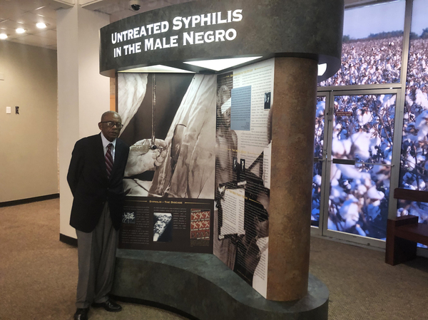 Tuskegee civil rights attorney Fred Gray shows an exhibit on the syphilis study at the Tuskegee History Center. Gray represented the men when the truth about the study came out in 1972. He won a $10 million settlement for the men, and their families.