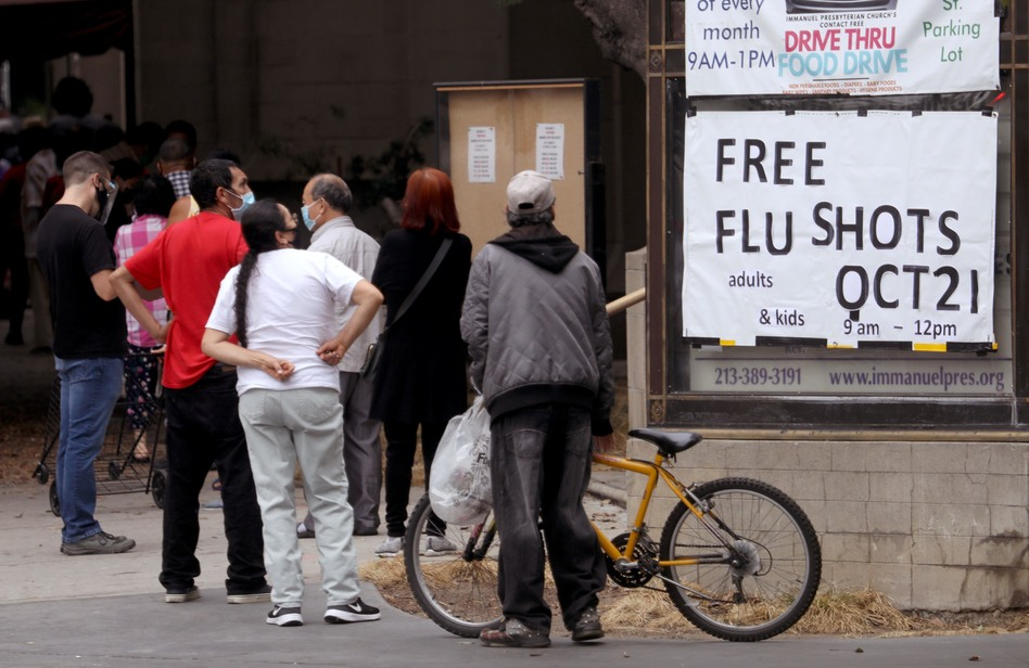 Last year, a record number of people got flu shots. But medical experts say kids keeping their social distance during the coronavirus pandemic has made the biggest difference for a mild flu season. (Genaro Molina/Los Angeles Times via Getty Images)