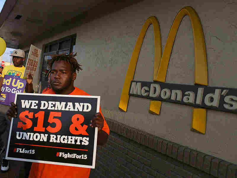 Demonstrators gather at a McDonald's restaurant as they demand an increase in the minimum wage to $15 an hour on April 14, 2016, in Miami.