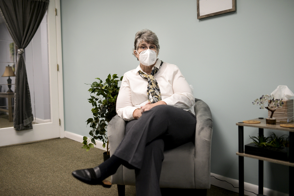 Jodee Pineau-Chaisson sits in her office in Springfield, Mass., on Jan. 12. Pineau-Chaisson, a social worker, contracted the coronavirus last May and continues to have symptoms even months after testing negative for the virus. (Meredith Nierman/GBH News)
