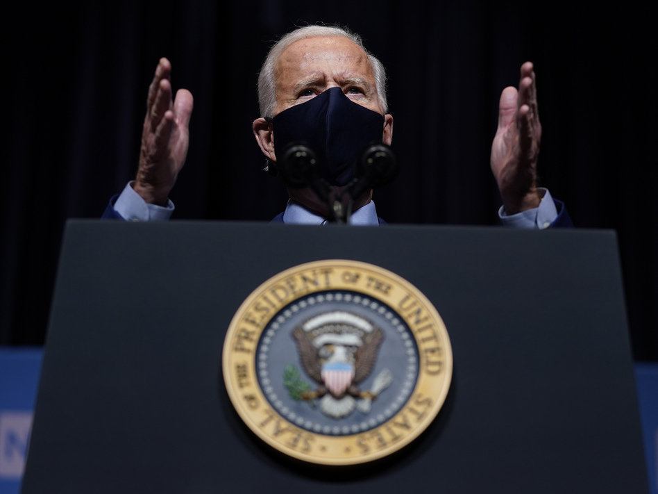 "President Biden said the attack on the Capitol ""has reminded us that democracy is fragile."" Above, Biden speaks during a visit Thursday to the National Institutes of Health in Bethesda, Md. (Evan Vucci/AP)"