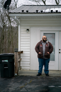 """Pastor Aaron Trigg fielded calls from his displaced congregants for months after the flood. """"A lot of people in Rainelle were poor, and they didn't have any insurance. They didn't have any way to have any backup plan."""" With no money to repair their homes, a lot of people took what they could salvage and left Rainelle for good."""
