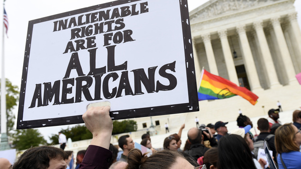 Protesters gather outside the Supreme Court in Washington where the Court on Oct. 8, 2019, as the court heard arguments in the first case of LGBT rights since the retirement of Supreme Court Justice Anthony Kennedy.