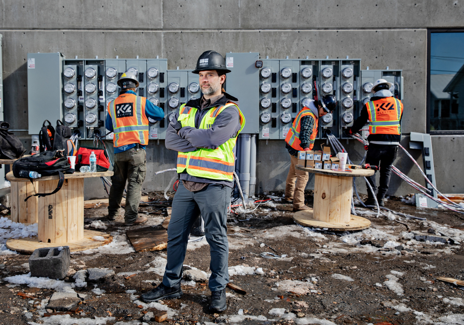"""Tyler Hollon, who works for a construction company in Utah, says eliminating natural gas from apartment buildings can reduce costs. Hollon's company now shares its designs and budgets with other builders. """"The reason we're giving it away is to clean up the air,"""" Hollon says. """"We want everybody to do it. It's everybody's air that we're all breathing. Makes my mountain bike ride that much easier."""" (Kim Raff for NPR)"""