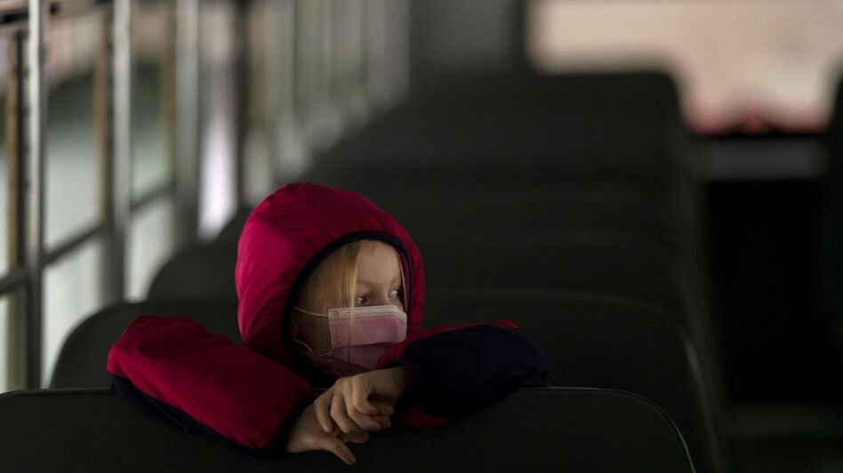 A first-grade student sits on the bus after a day of classes in Woodland, Wash., on Thursday. (Nathan Howard/Getty Images)
