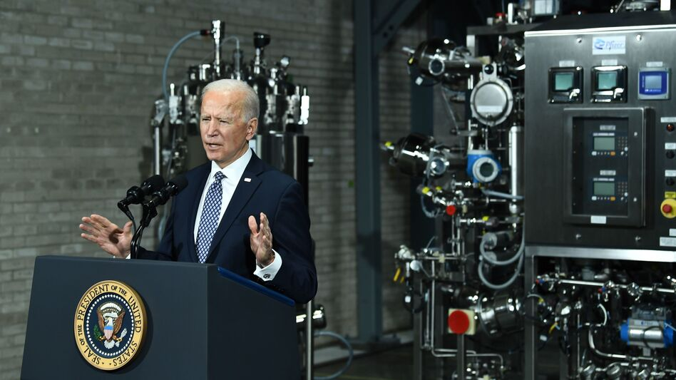 President Biden speaks Friday at a Pfizer COVID-19 vaccine manufacturing site in Portage, Mich. The House could pass a version of his $1.9 trillion COVID-19 relief legislation this week. (Brendan Smialowski/AFP via Getty Images)
