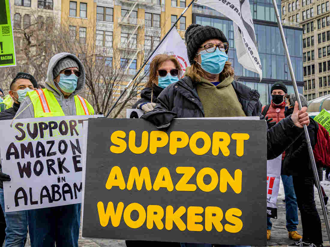 MANHATTAN, NEW YORK, UNITED STATES - 2021/02/20: Participants seen holding signs and marching on a picket line at the protest. Members of the Workers Assembly Against Racism gathered across from Jeff Bezos-owned Whole Foods Market in Union Square South for a nation-wide solidarity event with the unionizing Amazon workers in Bessemer, Alabama
