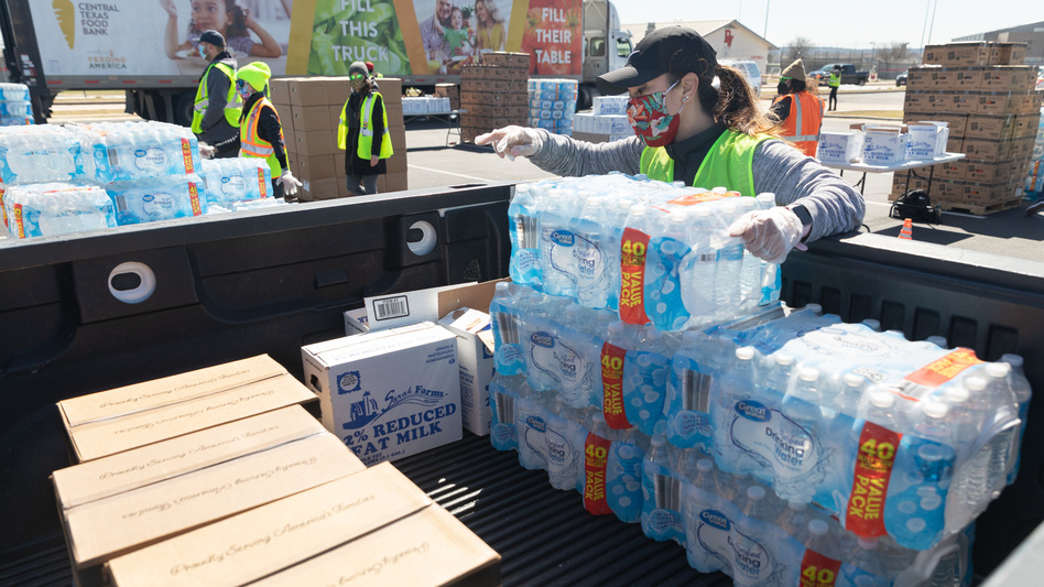One week after winter storms triggered boil-water notices in Texas, more than 8.7 million people are still affected. Here, a volunteer loads food and bottled water at a mass distribution site in Del Valle, Texas. (Thomas Ryan Allison/Bloomberg via Getty Images)