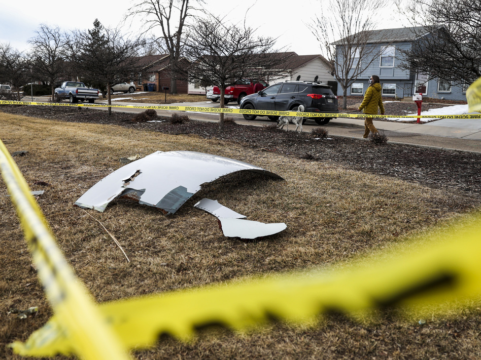 Pieces of an engine from United Airlines Flight 328 sit scattered in a neighborhood after the jet's engine failure on Saturday after takeoff from Denver. (Michael Ciaglo/Getty Images)