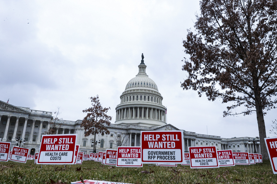 """Signs reading """"Help Still Wanted"""" are positioned on the lawn outside the U.S. Capitol on Jan. 5. The House is set to vote on a coronavirus relief package by the end of the week. (Tasos Katopodis/Getty Images)"""
