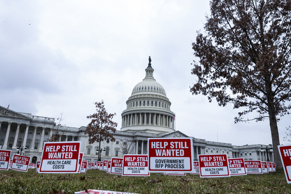 "Signs reading ""Help Still Wanted"" are positioned on the lawn outside the U.S. Capitol on Jan. 5. The House is set to vote on a coronavirus relief package by the end of the week."