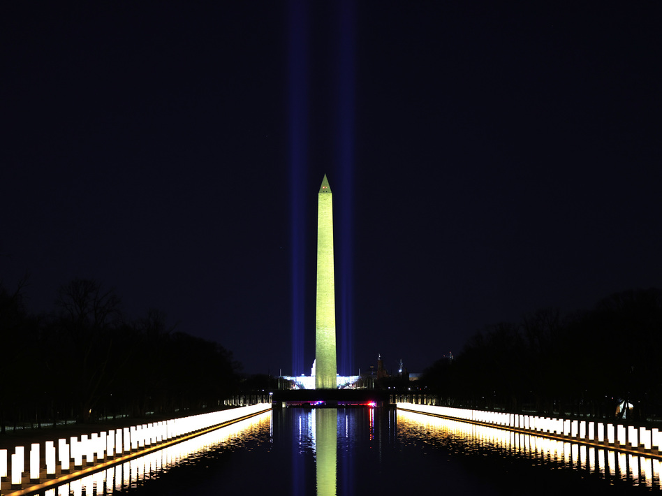 Columns along the sides of the Lincoln Memorial Reflecting Pool pay tribute to victims of COVID-19 at a Jan. 19 memorial. Just over a month later, a Monday evening ceremony will pay tribute to 500,000 Americans lives lost. (Michael M. Santiago/Getty Images)