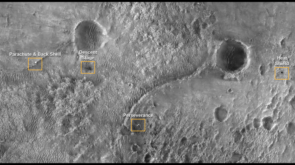 In this photograph taken by the Mars Reconnaissance Orbiter the various components of the Mars mission are seen on the planet's surface following landing. (NASA)
