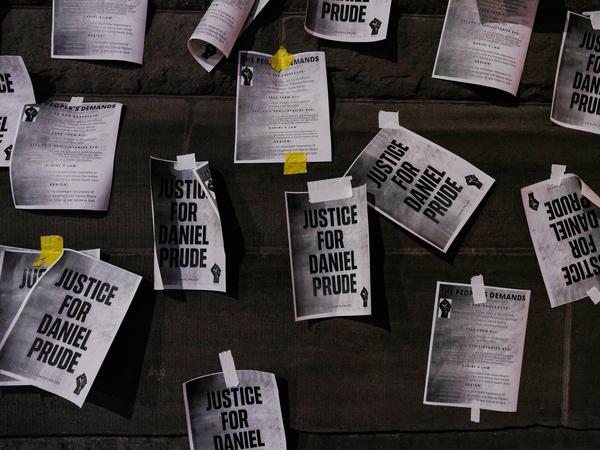 "Signs calling for ""Justice for Daniel Prude"" were plastered to the exterior walls of City Hall in Rochester, N.Y., on Sept. 8, the seventh consecutive night of protests following the release of bodycam footage showing the March arrest that preceded his death."