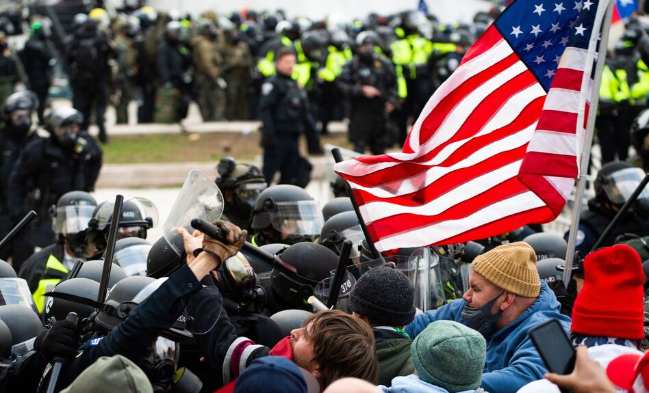 Rioters clash with police outside the Capitol on Jan. 6.