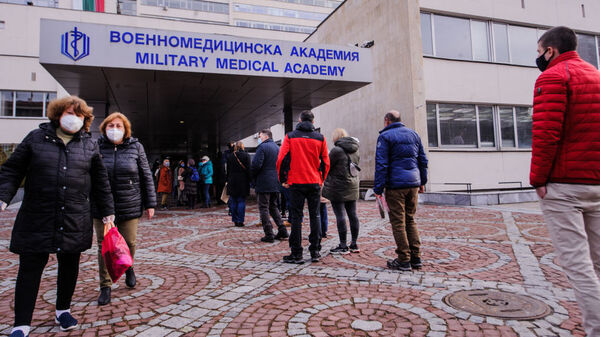 People wait in front of the hospital of the Military Medical Academy in Sofia, Bulgaria, on Feb. 21 for a COVID-19 vaccination.
