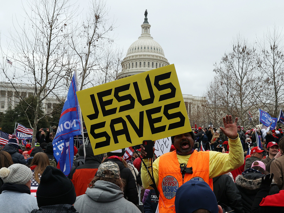Protesters gather outside the U.S. Capitol on Jan. 6 in Washington, D.C., some with signs and symbols of Christianity. Pro-Trump protesters entered the U.S. Capitol that day after mass demonstrations in the nation's capital. (Tasos Katopodis/Getty Images)