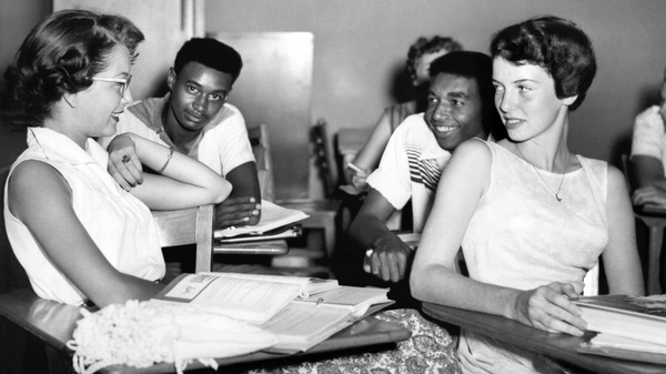 Students chat while waiting for history class to start at Oak Ridge High School in September of 1955, when the once all-white high school was desegregated by order of the Atomic Energy Commission. The Tennessee city