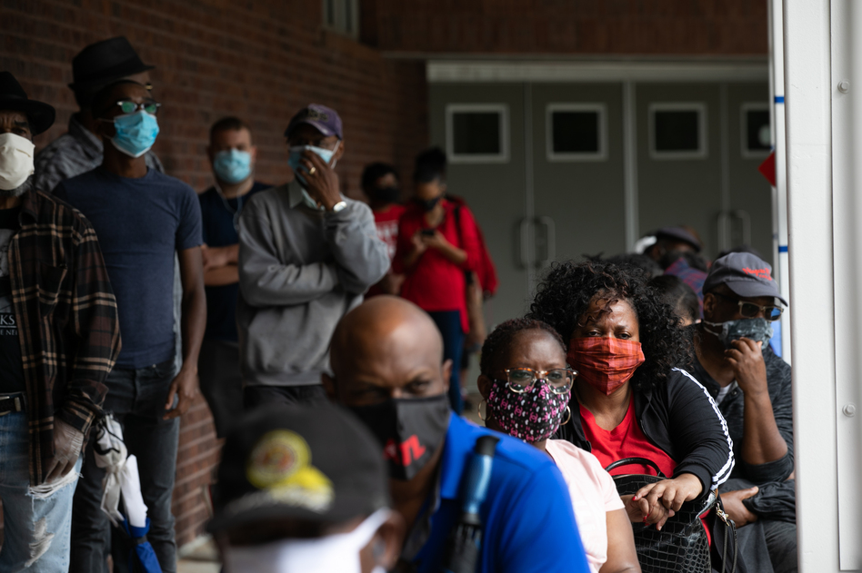 People wait in line on the first day of early voting for the 2020 general election on Oct. 12 in Atlanta. (Jessica McGowan/Getty Images)