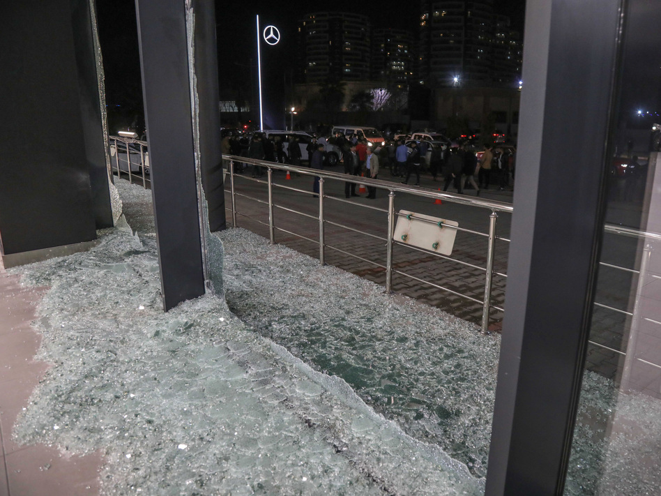 Shattered glass is on the ground following a rocket attack in Irbil, the capital of the northern Iraqi Kurdish autonomous region, on Feb. 15. On Thursday, the U.S. launched airstrikes targeting Iranian-backed groups in eastern Syria in response to recent attacks against Americans in Iraq. (Safin Hamed/AFP via Getty Images)