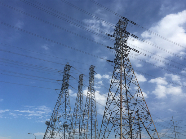 Electrical grid transmission towers in Pasadena, Calif. Major power outages from extreme weather have risen dramatically in the past two decades.