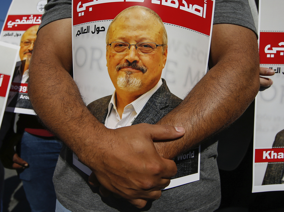 Lawmakers and journalists are among those calling for penalties against Saudi Crown Prince Mohammed bin Salman for the 2018 killing of <em>Washington Post</em> columnist Jamal Khashoggi after a U.S. intelligence report finding the crown prince had approved the operation. (Emrah Gurel/AP)