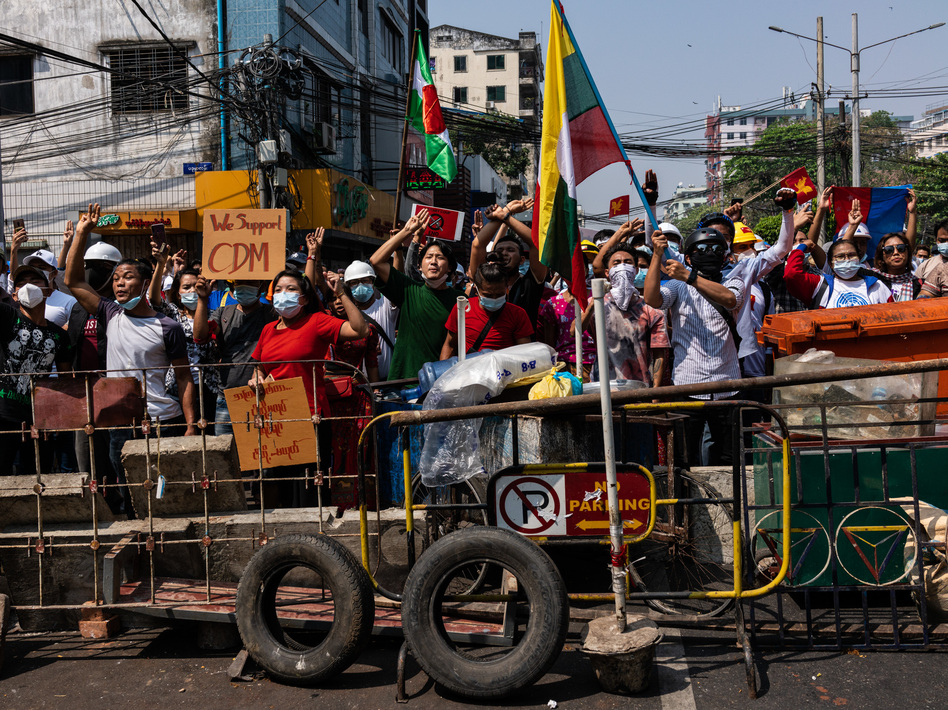 Anti-coup protesters in Yangon, Myanmar. Myanmar's military government has intensified a crackdown on protesters in recent days, using tear gas, charging at and arresting protesters and journalists. (Hkun Lat/Getty Images)