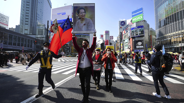 Myanmar people and supporters march during on Feb. 14 in Tokyo to protest the military coup.
