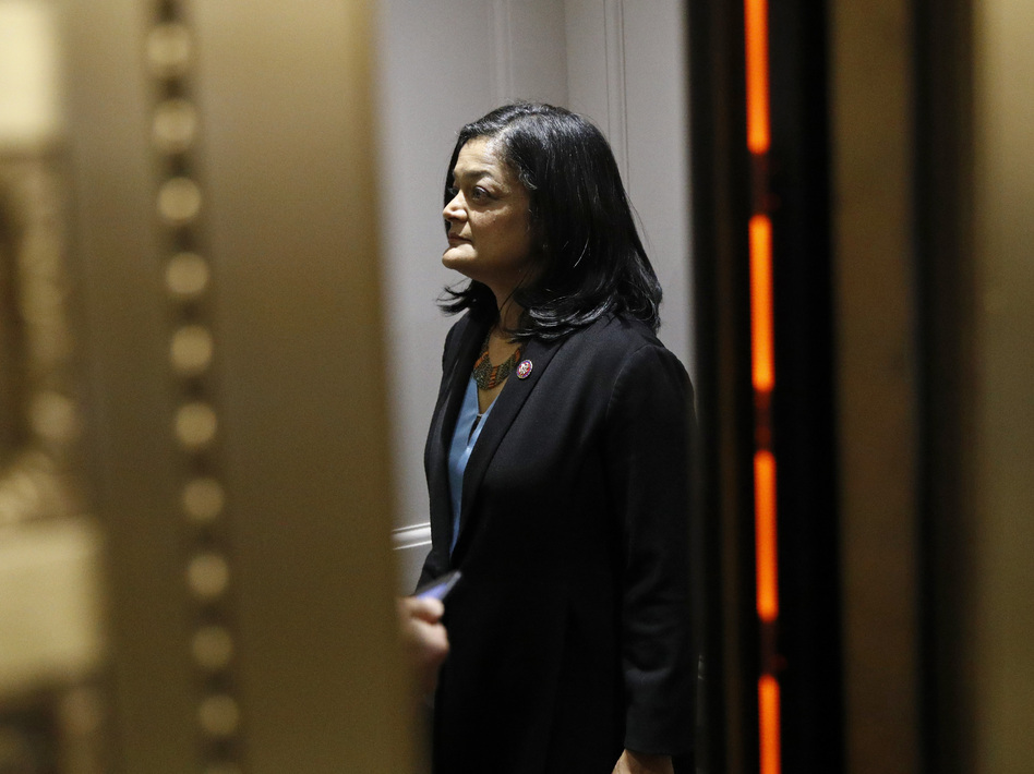 """""""You know, it's like a gut punch to millions of people,"""" Washington Rep. Pramila Jayapal, who chairs the House Progressive Caucus, said about the $15-an-hour minimum wage coming out of President Biden's COVID-19 relief package. But she says her vote will be based on the bill as a whole, even though it doesn't include the wage hike. (Patrick Semansky/AP)"""